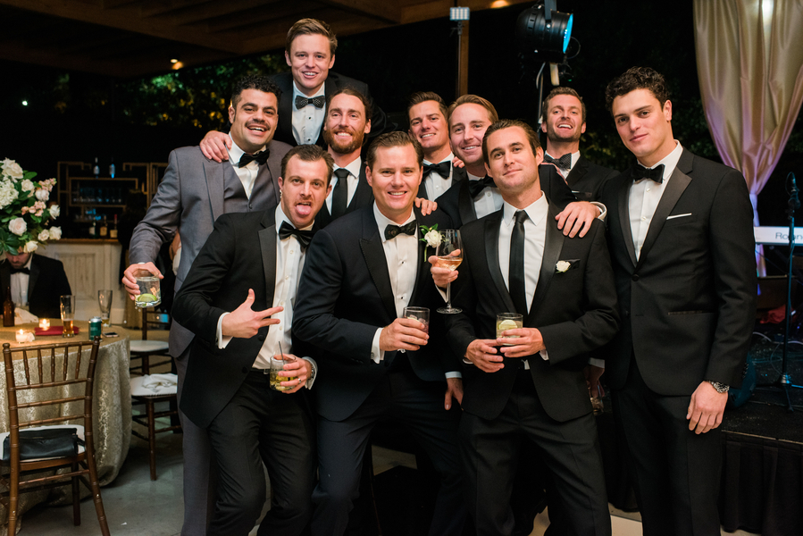 Groomsmen in black tuxedos at Savannah wedding reception