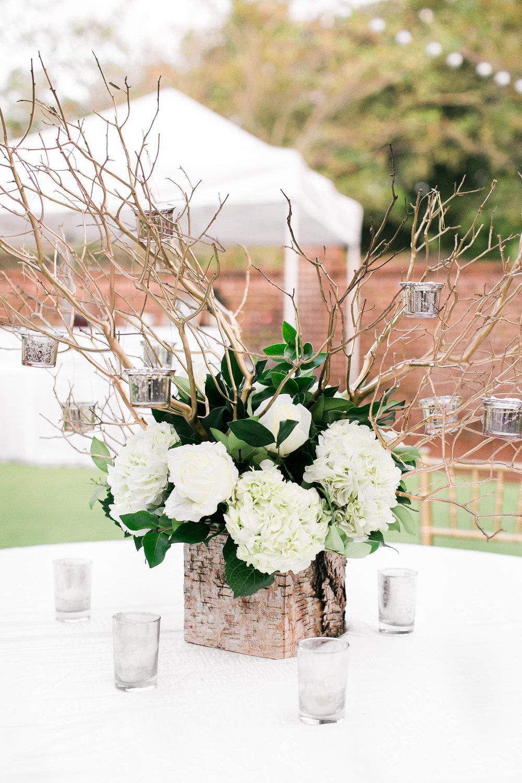 White hydrangea centerpieces by Fernwood Floral at Savannah Golf Club wedding