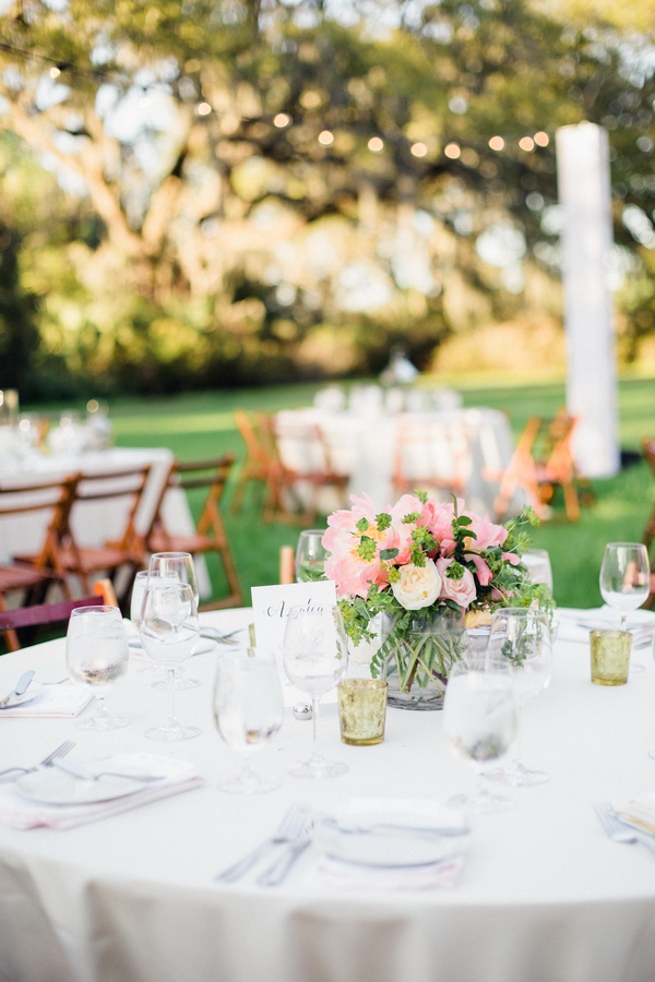 Pink peony centerpieces at Magnolia Plantation wedding in Charleston, South Carolina  //  Elegant two-tiered white wedding cake with pink peony accents in Charleston, SC //  Charleston wedding florist Duvall Events on A Lowcountry Wedding Magazine & Blog