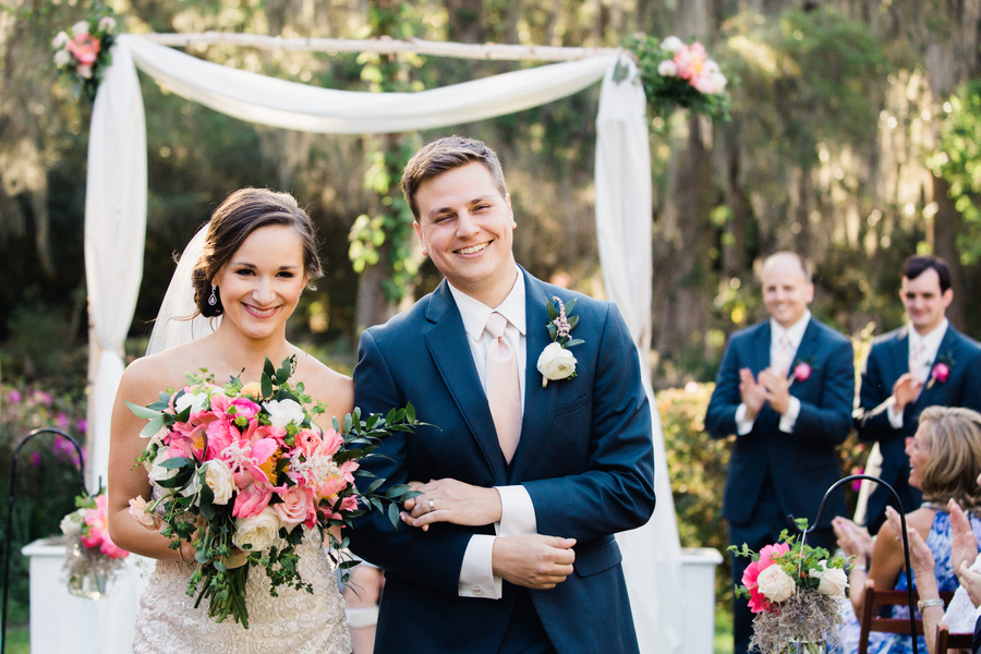 Bride and groom pronounced husband and wife at outdoor ceremony // Charleston wedding photography on A Lowcountry Wedding Magazine