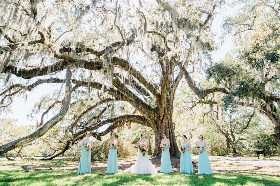 Bridesmaids in long mint dresses for a wedding at Magnolia Plantation & Gardens  / Charleston wedding venue on A Lowcountry Wedding Magazine