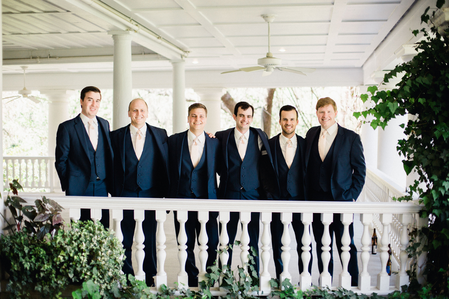 Groom with his groomsmen in navy suits // Charleston wedding photos by Phillip Casey Photography