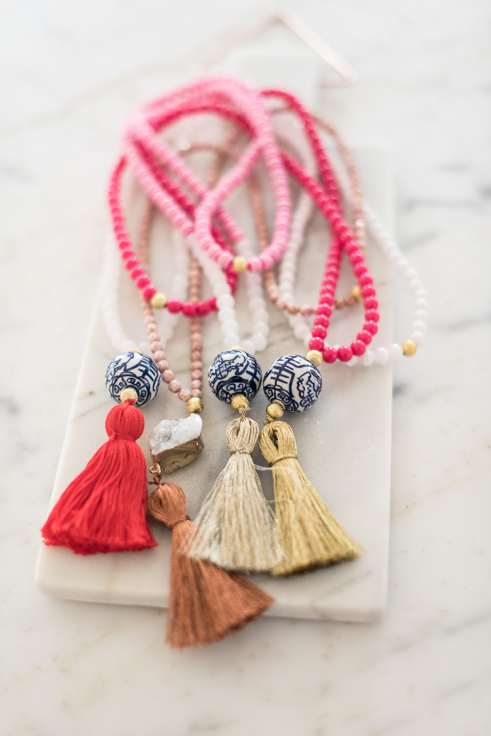 Pink tassel necklaces from The Tiny Tassel  //  designed by Liz Martin on Charleston Weekend  //  on A Lowcountry Wedding Magazine