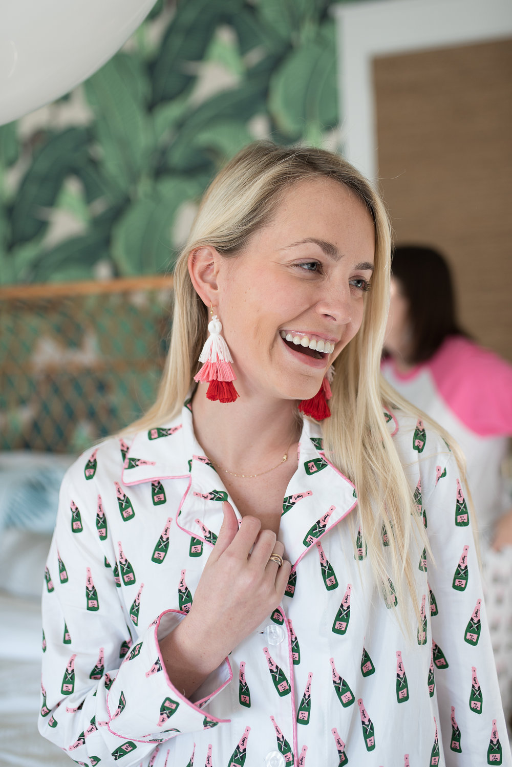 Slumber party with pink, white and red tassel earrings and champagne bottle pajamas  //  designed by Cayleigh Hopkins of The Petal Report  //  on A Lowcountry Wedding Magazine