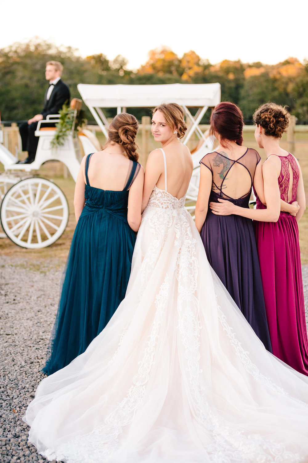 Bridesmaids in Hayley Paige dresses in front of white horse and carraige  //  Old South Carriage Company  //  Charleston wedding transportation  // Bride and her maids at Sugah Cain Plantation in front of white horse and Carriage  //  on A Lowocountry Wedding Magazine & Blog