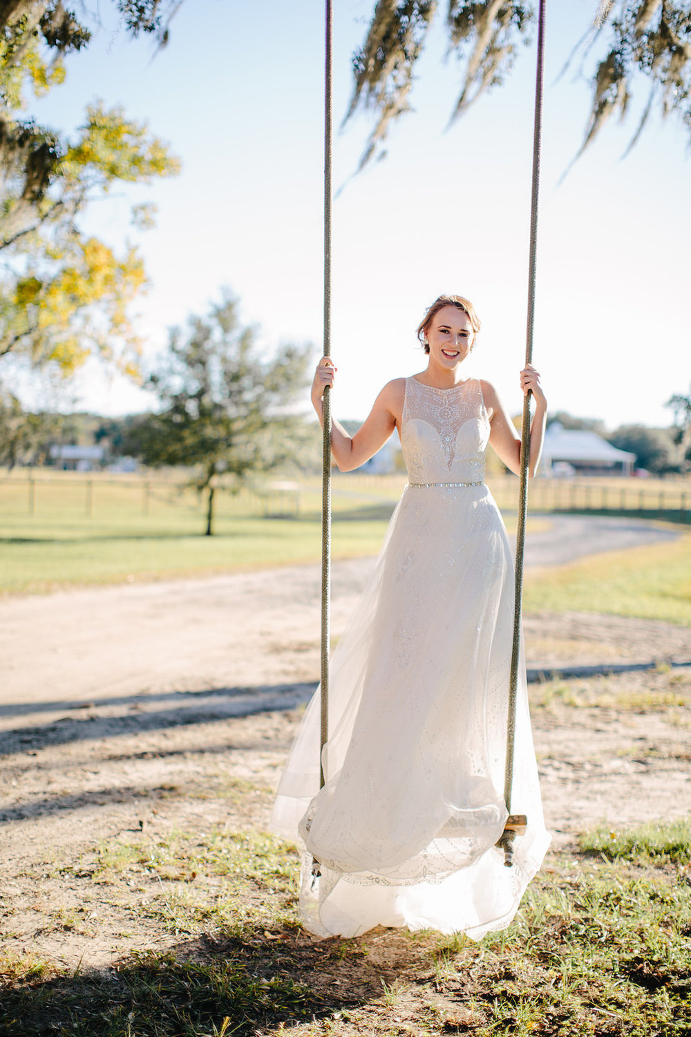 Bride on a swing at Sugah Cain Plantation  //  Charleston wedding photography by Carolina Photosmith  //  on A Lowocountry Wedding Magazine & Blog