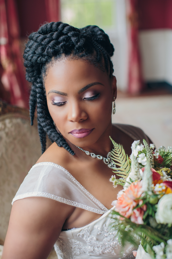 Bride with dramatic makeup and braids at The William Aiken House  // A Lowcountry Wedding Magazine & Blog
