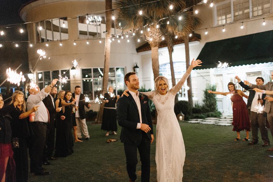 Bride and Groom exit King and Prince Resort wedding //  Saint Simons Island wedding photos  // A Lowcountry Wedding Magazine & Blog