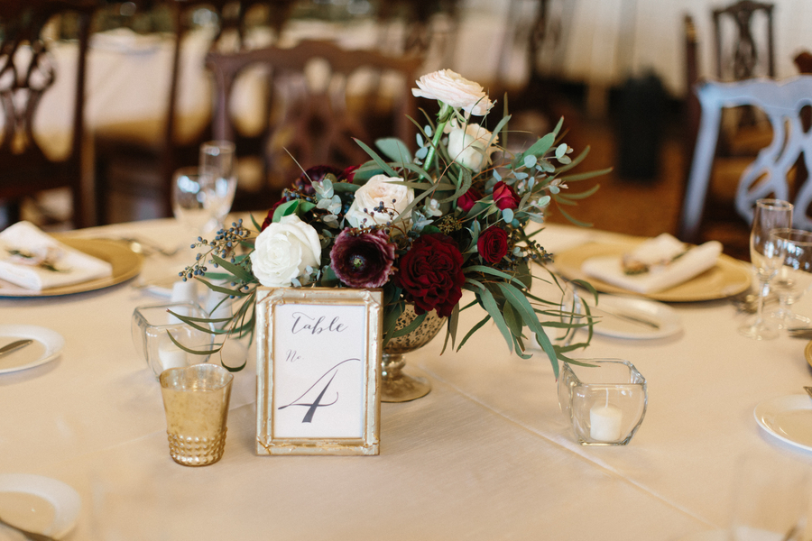 Organic deep red centerpieces in a gold footed bowl by Gertie Mae's   //  Saint Simons Island wedding photos by River West Photography // A Lowcountry Wedding Magazine & Blog