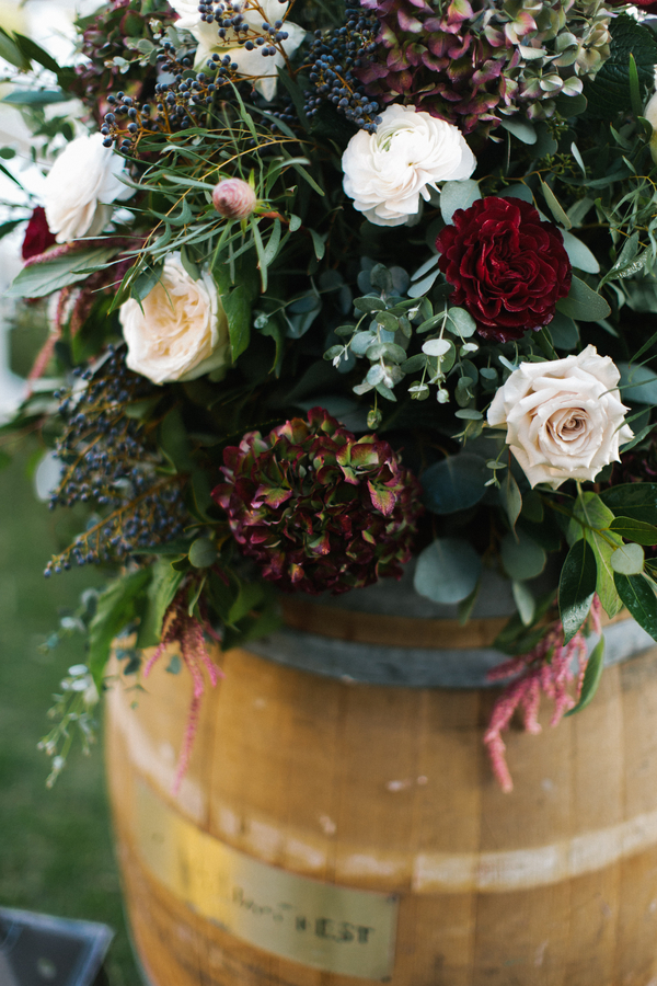 Winter wedding flowers with berries by Gertie Mae's Floral  //  Deven & Justin's King & Prince Resort wedding  //  Saint Simons Island, Georgia wedding venue  // A Lowcountry Wedding Magazine & Blog