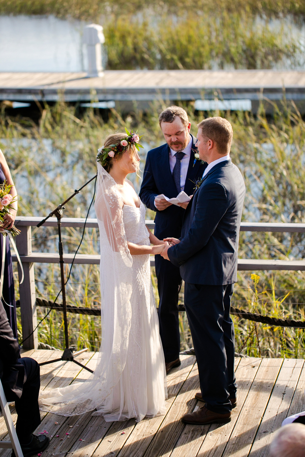 Outdoor ceremony overlooking the marina at Charleston Yacht Club wedding //  Charleston wedding photography by Jeanne Mitchum Photography // on A Lowcountry Wedding Magazine & Blog