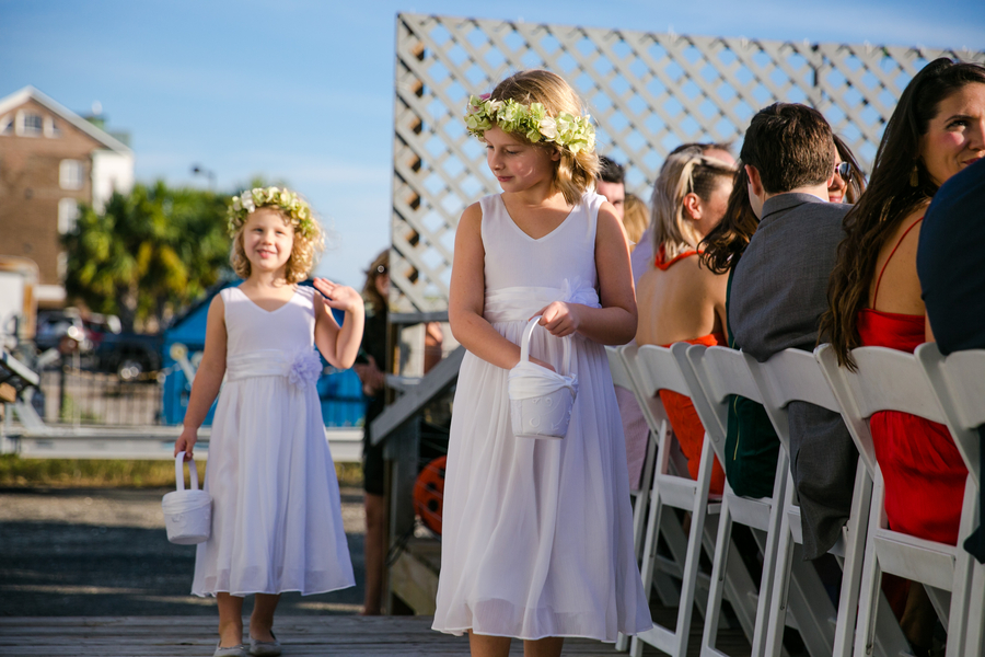 Flower girls walking down the aisle at Charleston Yacht Club wedding //  Charleston wedding photography by Jeanne Mitchum Photography // on A Lowcountry Wedding Magazine & Blog