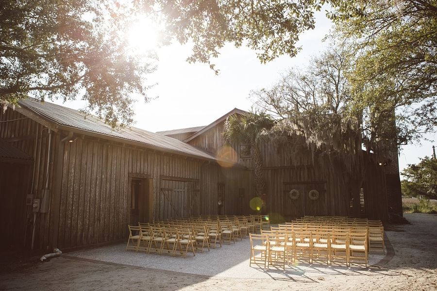 Outdoor ceremony on the patio at The Cotton Dock  //  Charleston wedding photos by amelia + dan photography  //  A Lowcountry Wedding Magazine & Blog