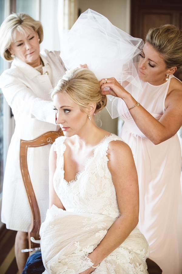Mother of the Bride helping daughter with her veil  //  Charleston wedding photos by amelia + dan photography  //  A Lowcountry Wedding Magazine & Blog