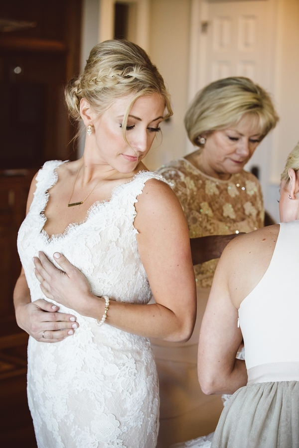 Bride in her wedding dress with braided up-do  //  Charleston wedding photos by amelia + dan photography  //  A Lowcountry Wedding Magazine & Blog
