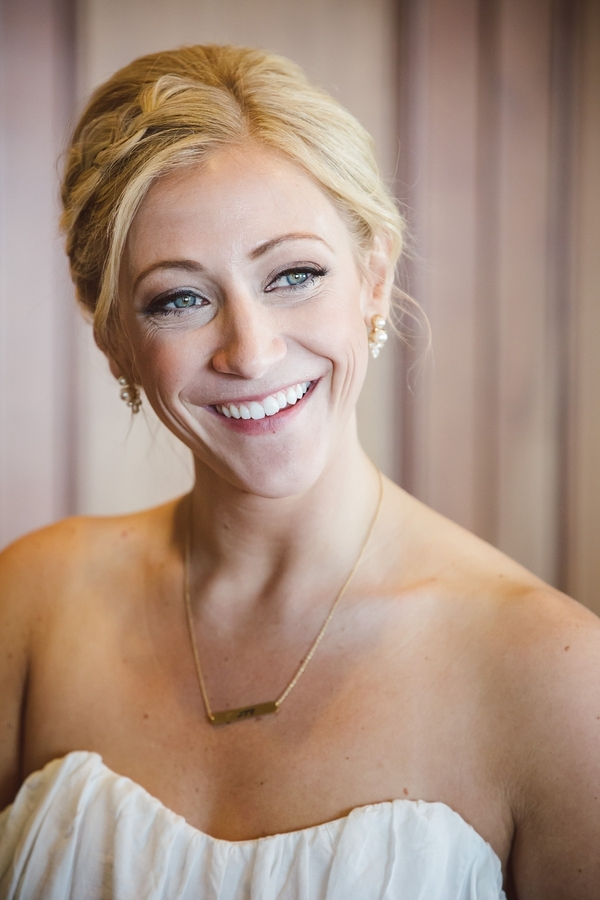 Bride with natural makeup and braided up-do  //  Charleston wedding photos by amelia + dan photography  //  A Lowcountry Wedding Magazine & Blog