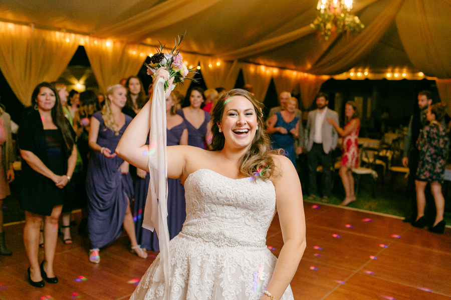 Bouquet toss at Oak Point Plantation wedding on Johns Island, SC  //  Charleston wedding photographer Riverland Studios  //  A Lowcountry Wedding Magazine & Blog
