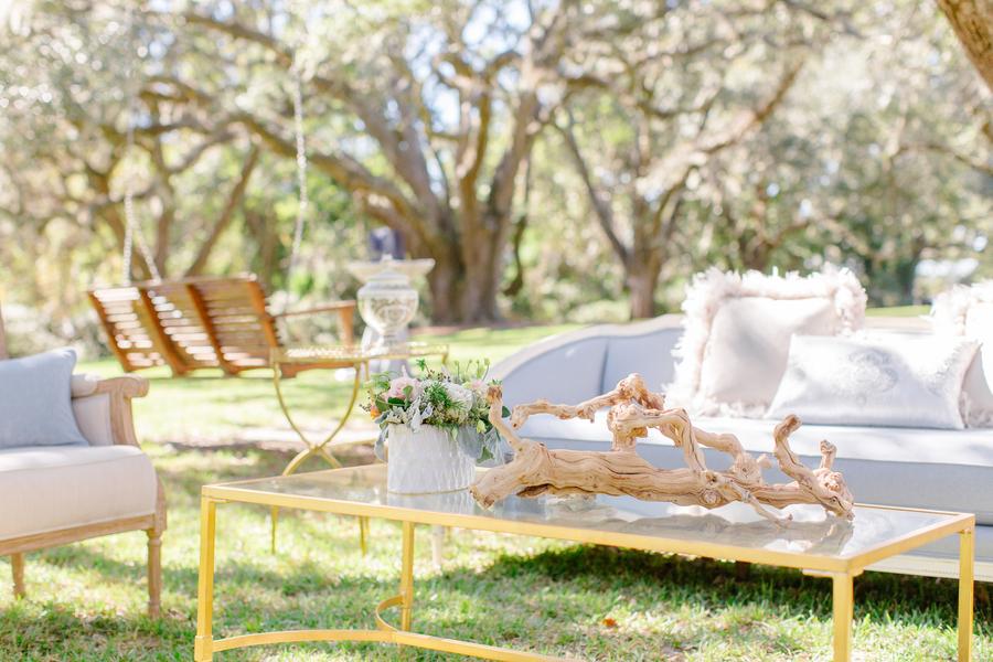 Vintage sofa and gold coffee table at Oak Point Plantation wedding on Johns Island, SC  //  Charleston wedding photographer Riverland Studios  //  A Lowcountry Wedding Magazine & Blog