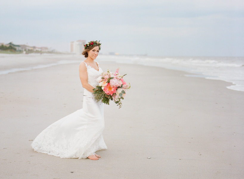 Bride wearing Casablanca gown on the beach with pink peony bouquet  at Grande Dunes Ocean Club  //  Myrtle Beach wedding photos by Gillian Claire Photography  //  A Lowcountry Wedding Magazine & Blog