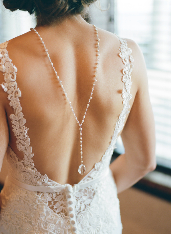 Bride wearing backdrop necklace and Casablanca wedding gown  //  Myrtle Beach wedding photos by Gillian Claire Photography  //  A Lowcountry Wedding Magazine & Blog