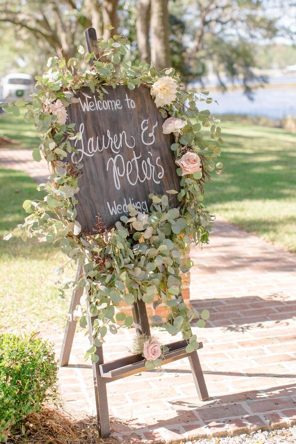 Hand-lettered wedding welcome sign at Oak Point Plantation  //  Charleston wedding photographer Riverland Studios  //  A Lowcountry Wedding Magazine & Blog