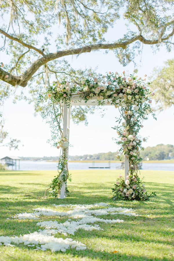 Floral adorned ceremony arbor at Oak Point Plantation  //  A Lowcountry Wedding Magazine & Blog