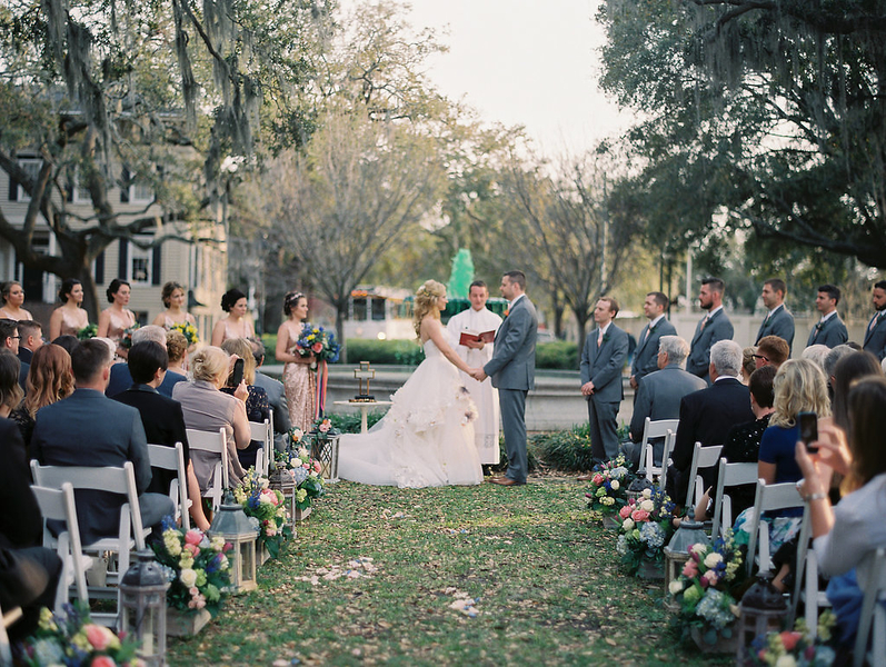 Outdoor ceremony at Orleans Square with green fountain during St. Patrick's Day  //  Savannah wedding photos by Alison Epps Photography  //  A Lowcountry Wedding Magazine & Blog