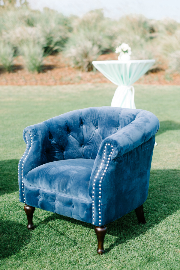 Vintage blue lounge furniture at outdoor wedding reception