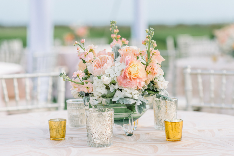 Spring floral centerpieces with peach ranunculus, roses and hydrangeas at The Ocean Course by Branch Design Studio