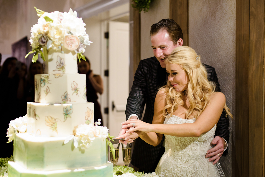 Bride & groom cutting a five-tiered Minette Rushing Custom Cake at Palmetto Bluff  //  Hilton Head Island wedding photos by Donna Von Bruening  //  A Lowcountry Wedding Magazine & Blog