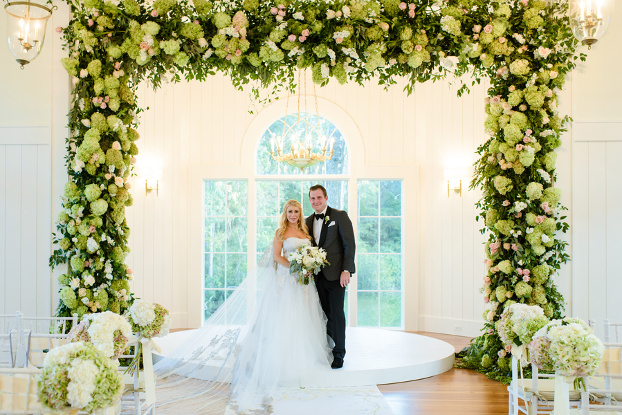 Green and white hydrangea ceremony arbor at Palmetto Bluff's May River Chapel in Bluffton, South Carolina designed by Todd Events  //  Hilton Head Island wedding photos by Donna Von Bruening  //  A Lowcountry Wedding Magazine & Blog