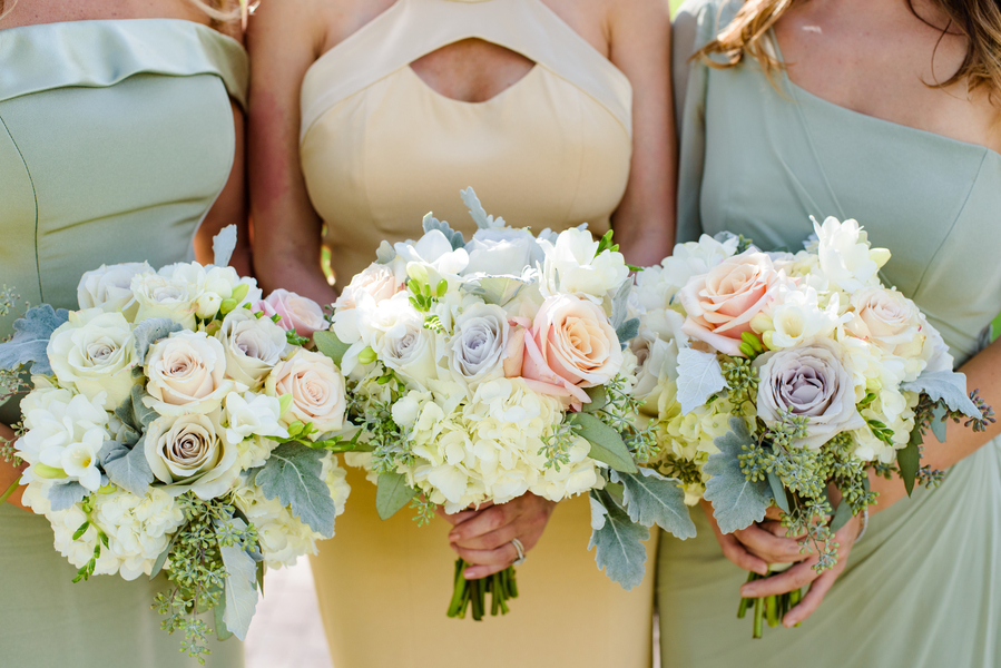 Bridesmaids Spring bouquets with white hydrangeas, soft beach and pale purple roses by Todd Events  //  Hilton Head Island wedding photos by Donna Von Bruening  //  A Lowcountry Wedding Magazine & Blog