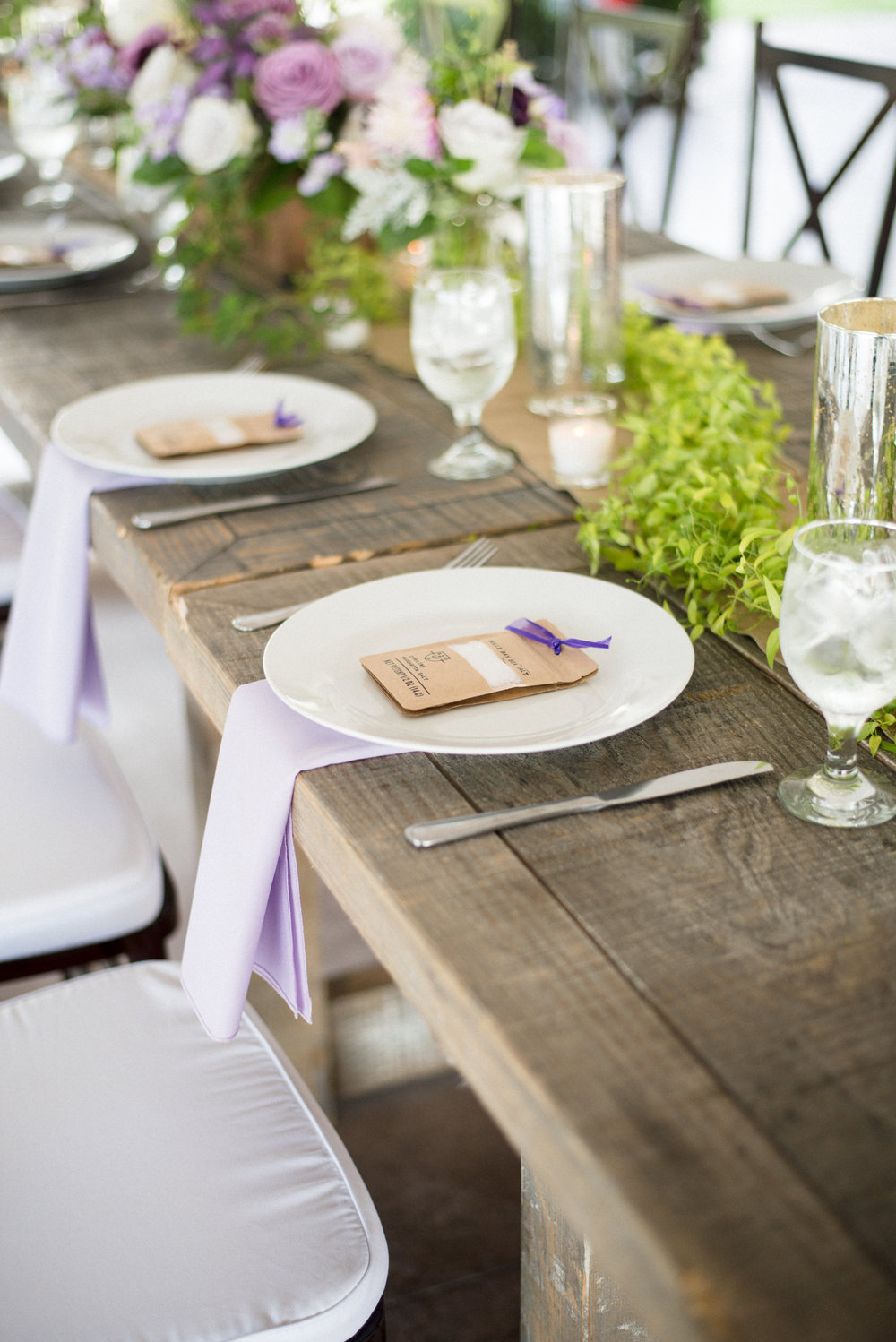 Lavender wedding reception decor with farm tables at The Island House