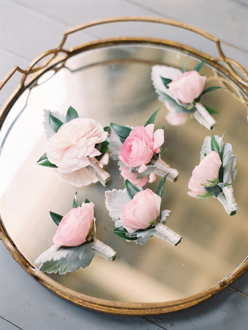 Pale pink ranunculus boutonneires by Stephanie Gibbs Events for wedding at Oldfield Club  //  A Lowcountry Wedding Magazine