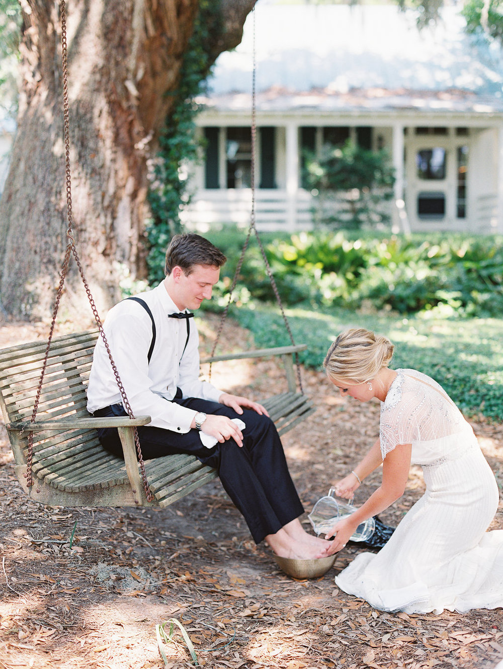 Hilton Head bride washing groom's feet at Oldfield Club  //  A Lowcountry Wedding Magazine