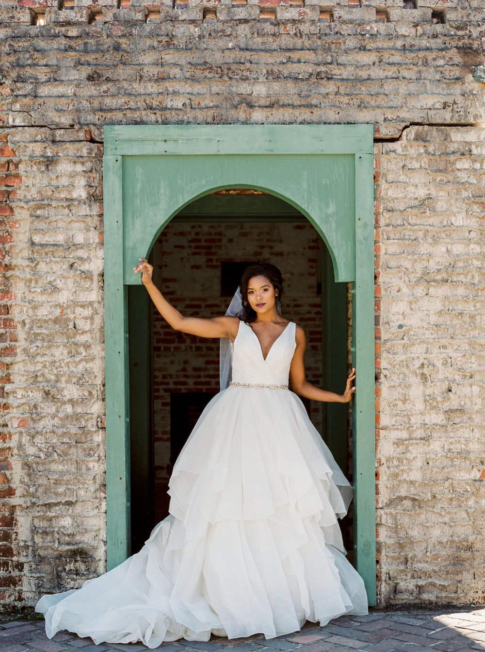 Morilee by Madeline Gardner dress from Mary Elizabeth Bridal at Atalaya Castle // Photographed by JoPhoto // Event Styling by The Petal Report  // A Lowcountry Wedding Magazine