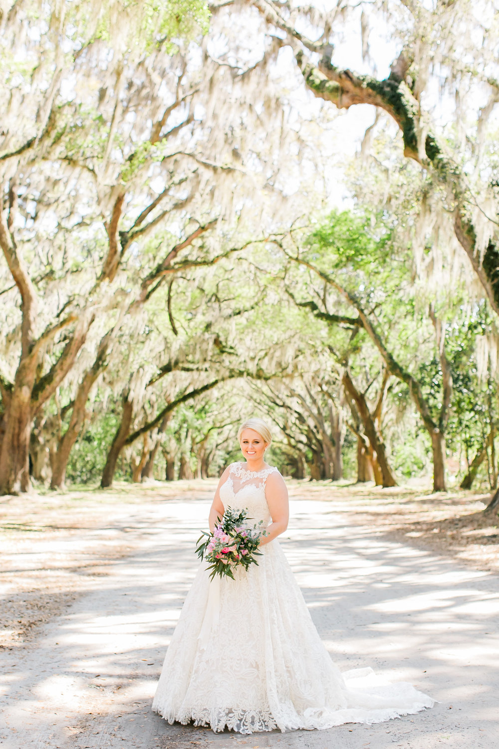 Savannah GA bride in lace gown for destination wedding at Wormsloe Plantation  //  A Lowcountry Wedding Magazine