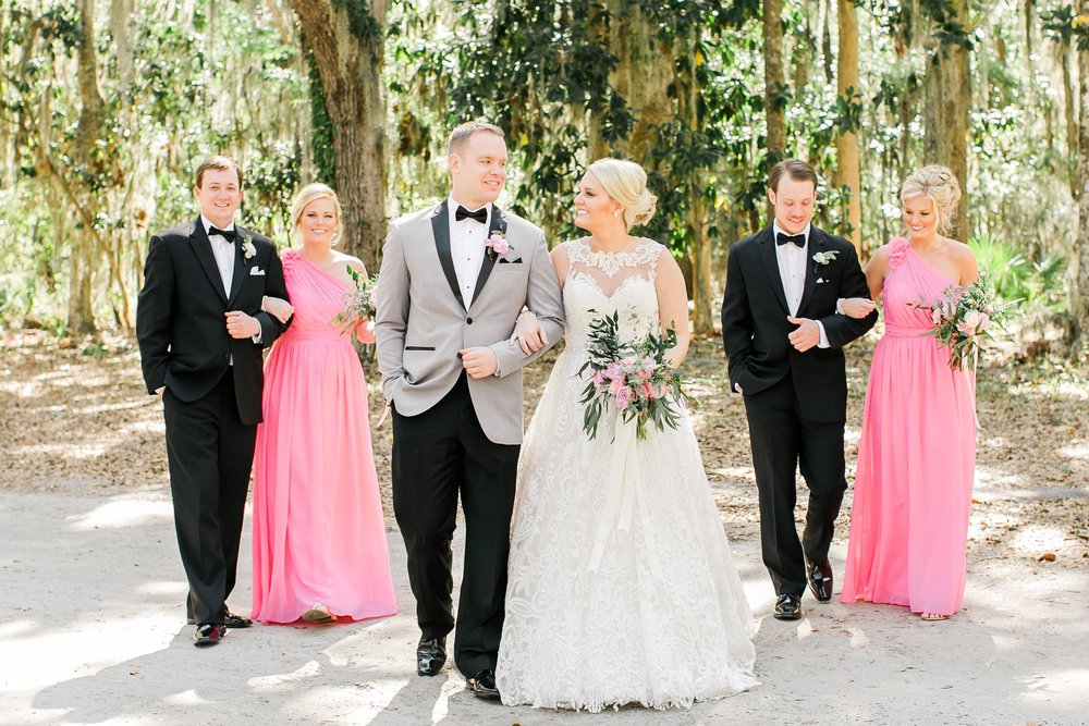 Bridesmaids in long pink dresses at Wormsloe Plantation in Savannah GA  //  A Lowcountry Wedding Magazine