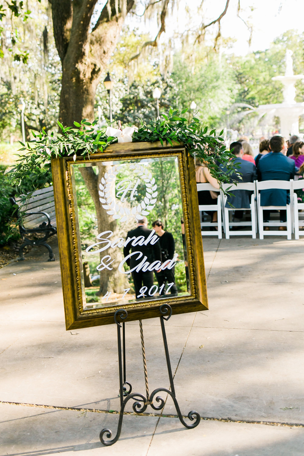 Hand-lettered welcome sign at Forsyth Park wedding ceremony in Savannah GA