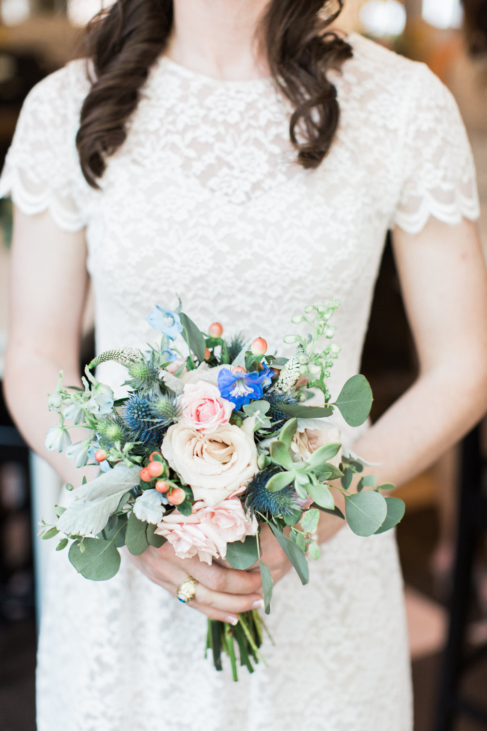 Blue thistle, succulent and peach rose bouquet by Urban Poppy  //  A Lowcountry Wedding Magazine