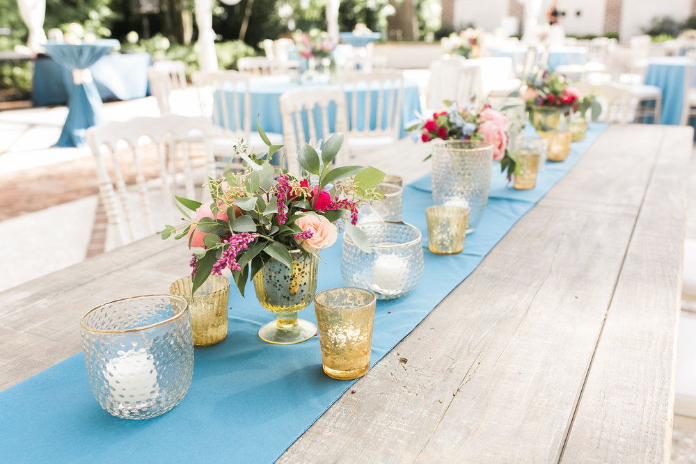 Colorful outdoor reception at The Thomas Bennett House wedding in Charleston, SC  //  photographed by Jenna Weddings  Traditional wedding ceremony at Cathedral of St. John the Baptist in Charleston, SC  //  A Lowcountry Wedding Magazine & Blog