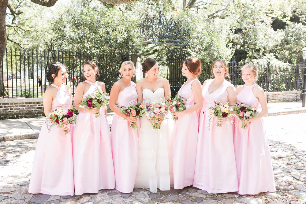 Bride with her bridesmaids in pale pink LulaKate dresses  Colorful outdoor reception at The Thomas Bennett House wedding in Charleston, SC  //  photographed by Jenna Weddings  Traditional wedding ceremony at Cathedral of St. John the Baptist in Charleston, SC  //  A Lowcountry Wedding Magazine & Blog