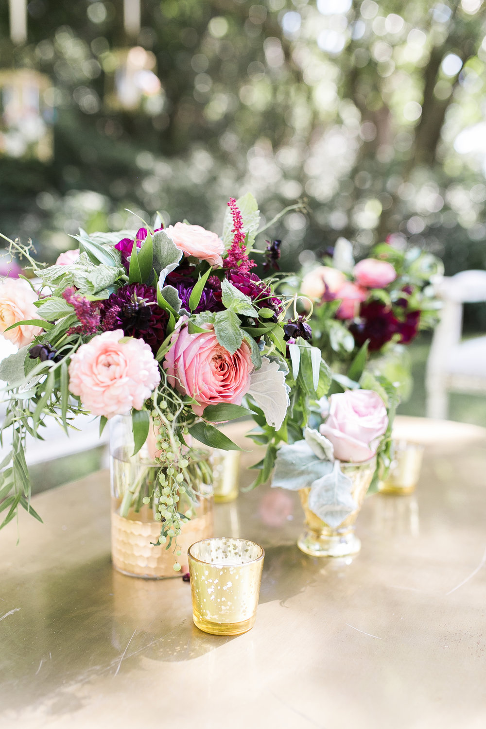 Colorful centerpieces in gold vases by Branch Design Studio at wedding in Charleston, SC Colorful outdoor reception at The Thomas Bennett House wedding in Charleston, SC  //  photographed by Jenna Weddings  Traditional wedding ceremony at Cathedral of St. John the Baptist in Charleston, SC  //  A Lowcountry Wedding Magazine & Blog