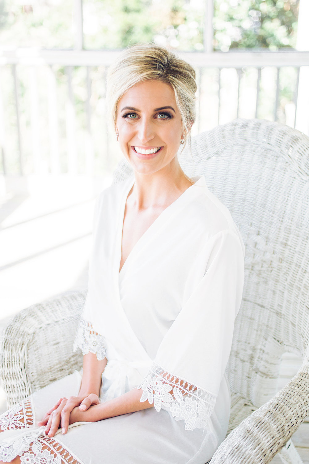 Bride wearing a white lace robe for a wedding at DeBordieu Club  //  A Lowcountry Wedding Magazine & Blog