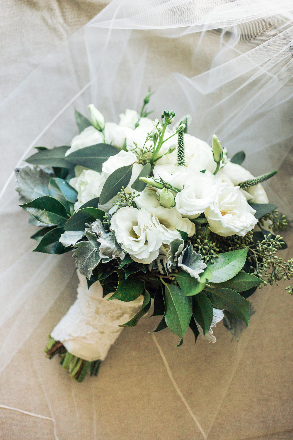 Elegant bouquet of all white flowers for a Georgetown SC wedding by Carolina Charm Florist  //  A Lowcountry Wedding Magazine & Blog