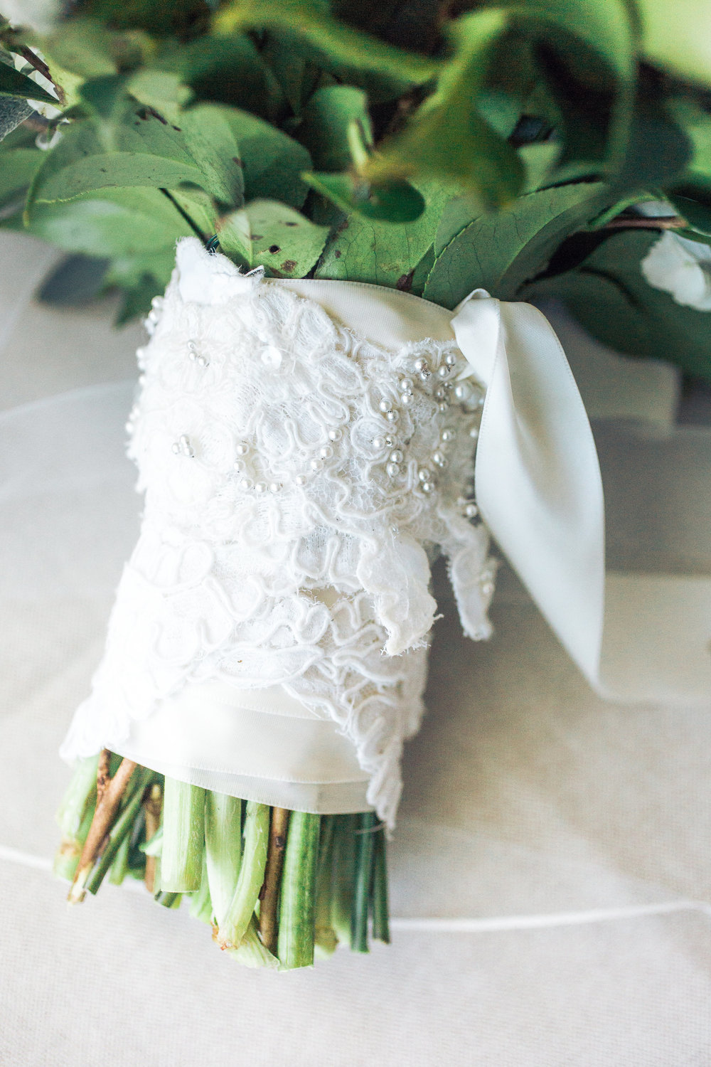 Myrtle Beach bride's bouquet wrapped in lace from her mother's dress  //  A Lowcountry Wedding Magazine & Blog