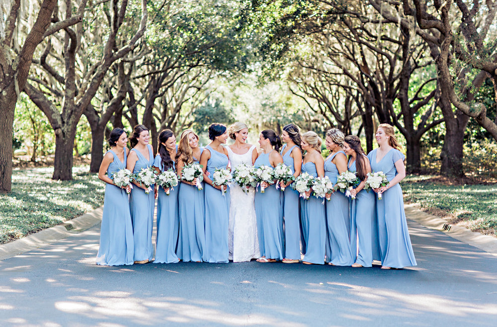 Bridesmaids in blue Monique Lhuillier floor length dresses for a wedding at DeBordieu Club  //  A Lowcountry Wedding Magazine & Blog