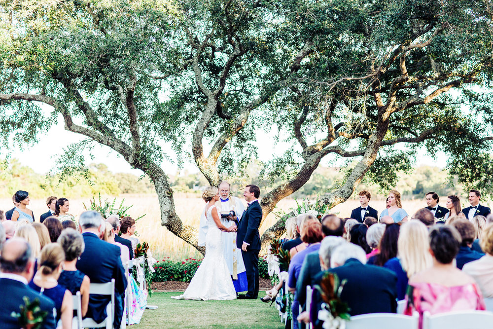 Outdoor wedding ceremony under the oak tree at The DeBordieu Club  //  A Lowcountry Wedding Magazine & Blog