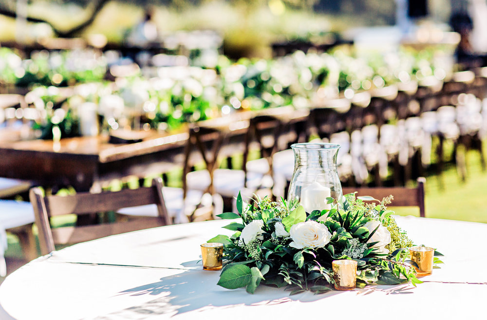 Outdoor reception with rustic details and greenery at wedding in Georgetown, SC  //  A Lowcountry Wedding Magazine & Blog