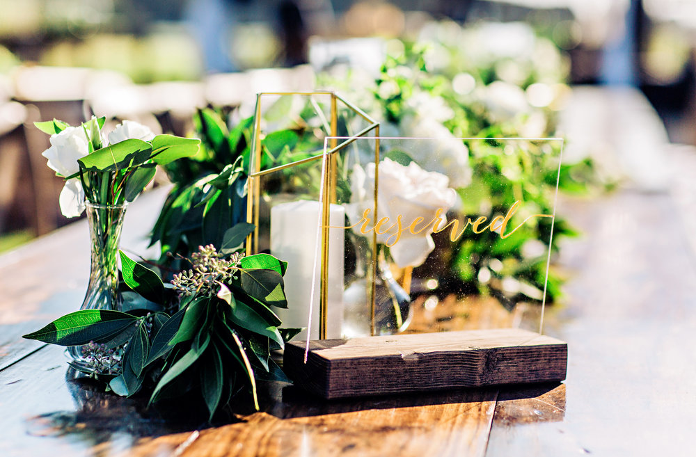 Greenery table runners on rustic farm tables with acrylic table numbers //  A Lowcountry Wedding Magazine & Blog